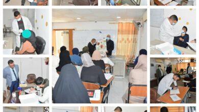 صورة فريق طبي يزور كلية الامام الكاظم (ع) اقسام النجف الأشرف للتوعية من مخاطر فيروس كورونا(كوفيد-19)